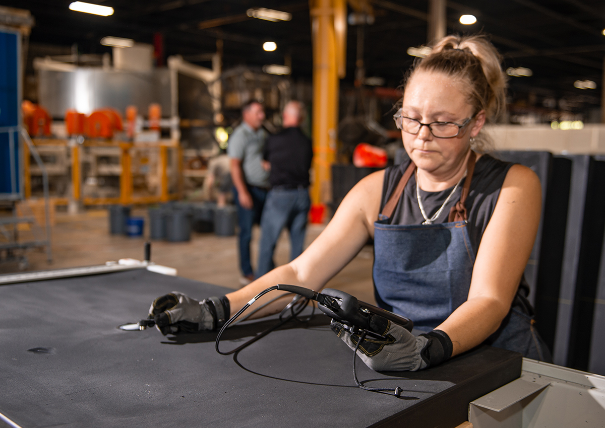 Woman checking quality of product
